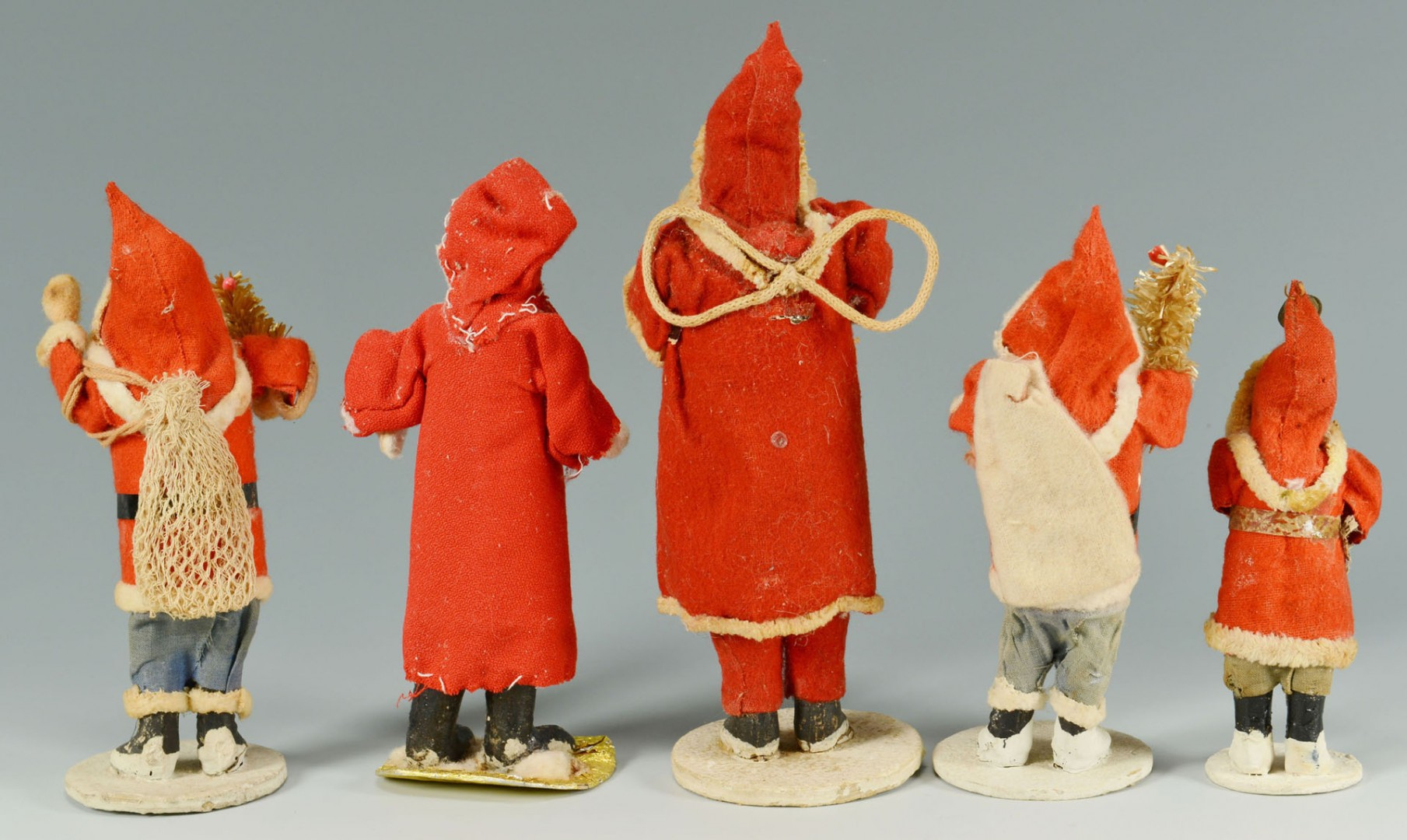 Grouping of five (5) early standing Santa figures