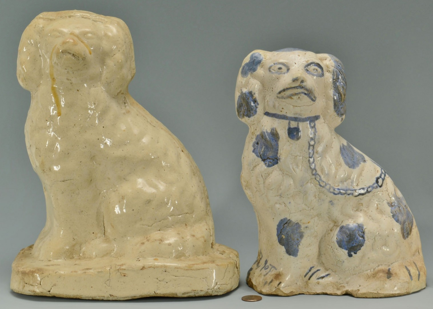 Lot 61: Grouping of 4 Sewer Tile Spaniel Dogs