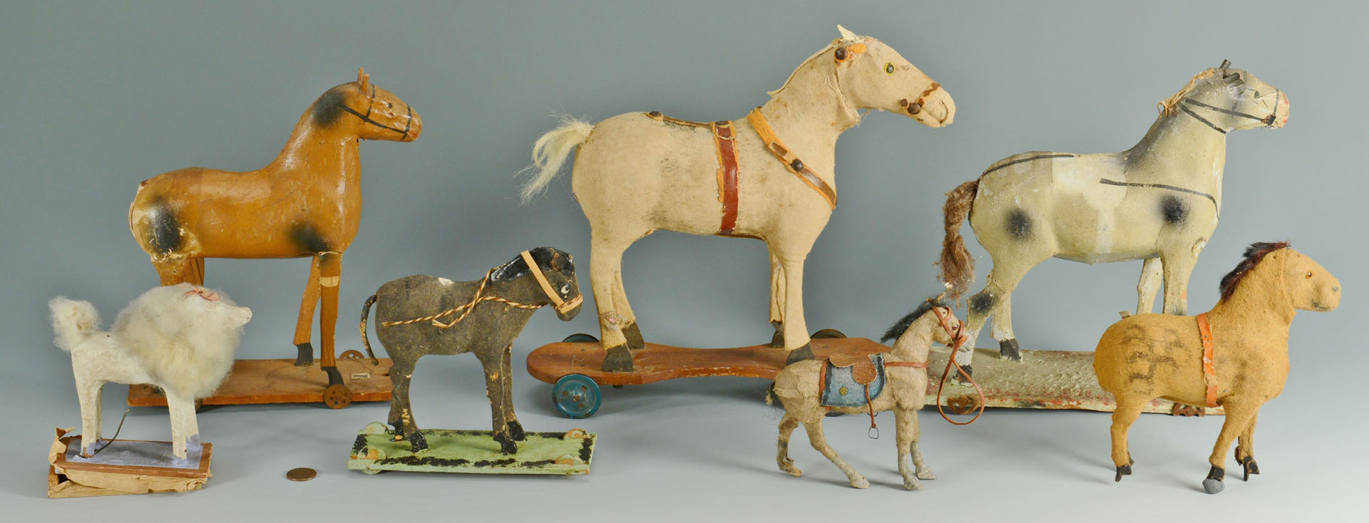 Group of  7 early pull toys and animals