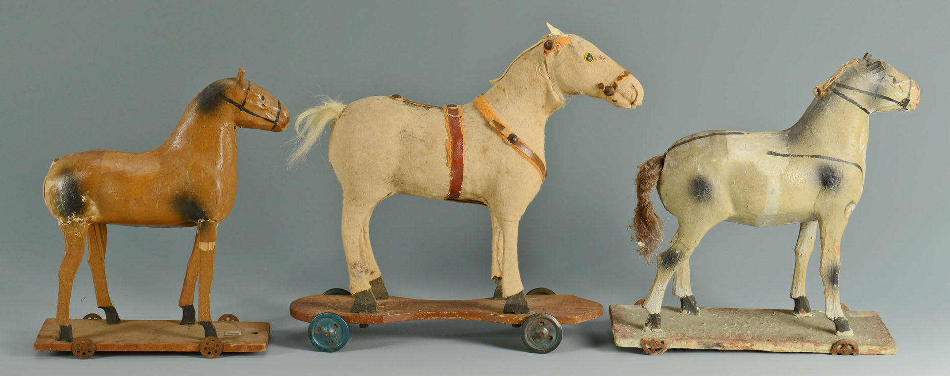 Lot 667: Group of 7 early pull toys and animals