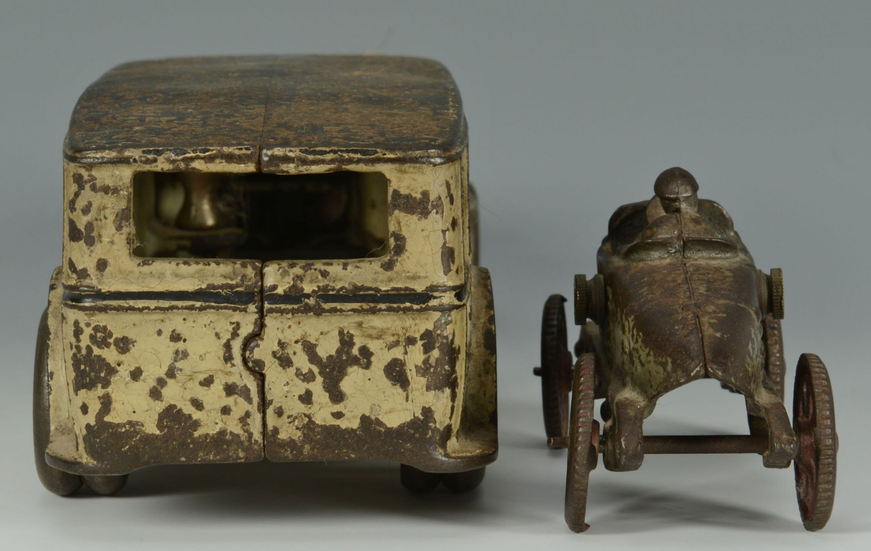 Two cast iron vehicles, Fageol & other
