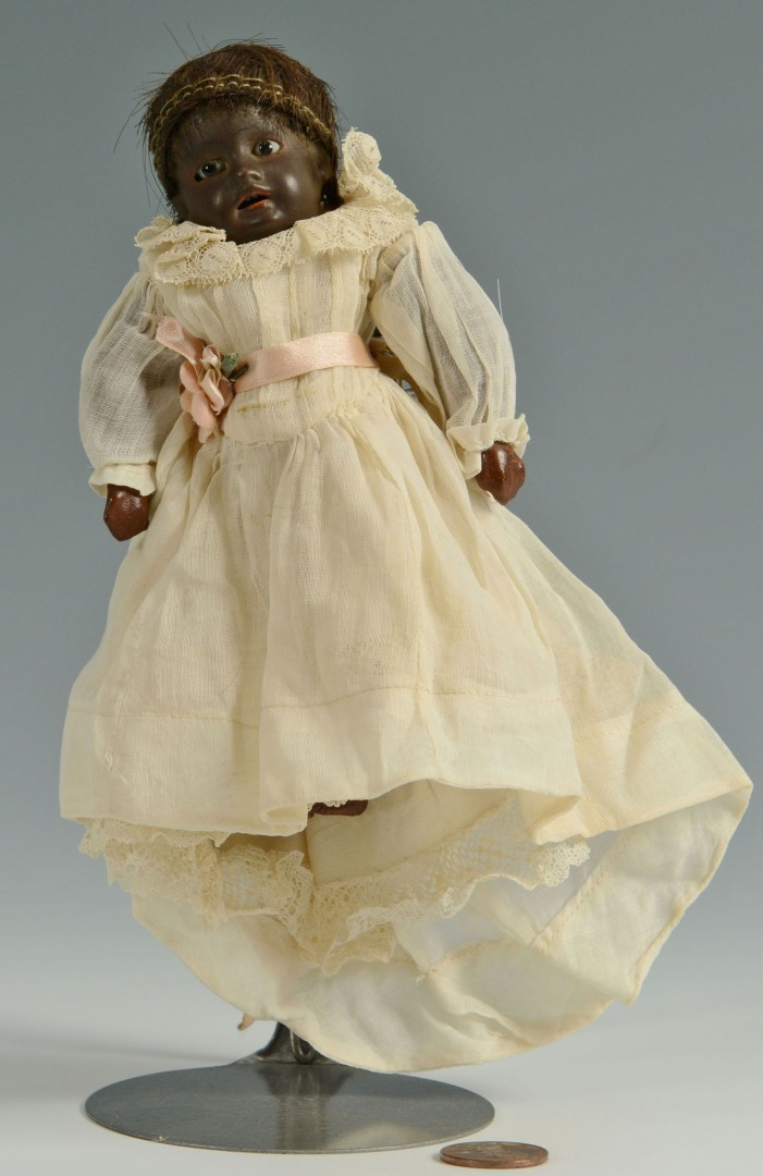 Lot 675: Early black tiny character doll, Kuhnlenz