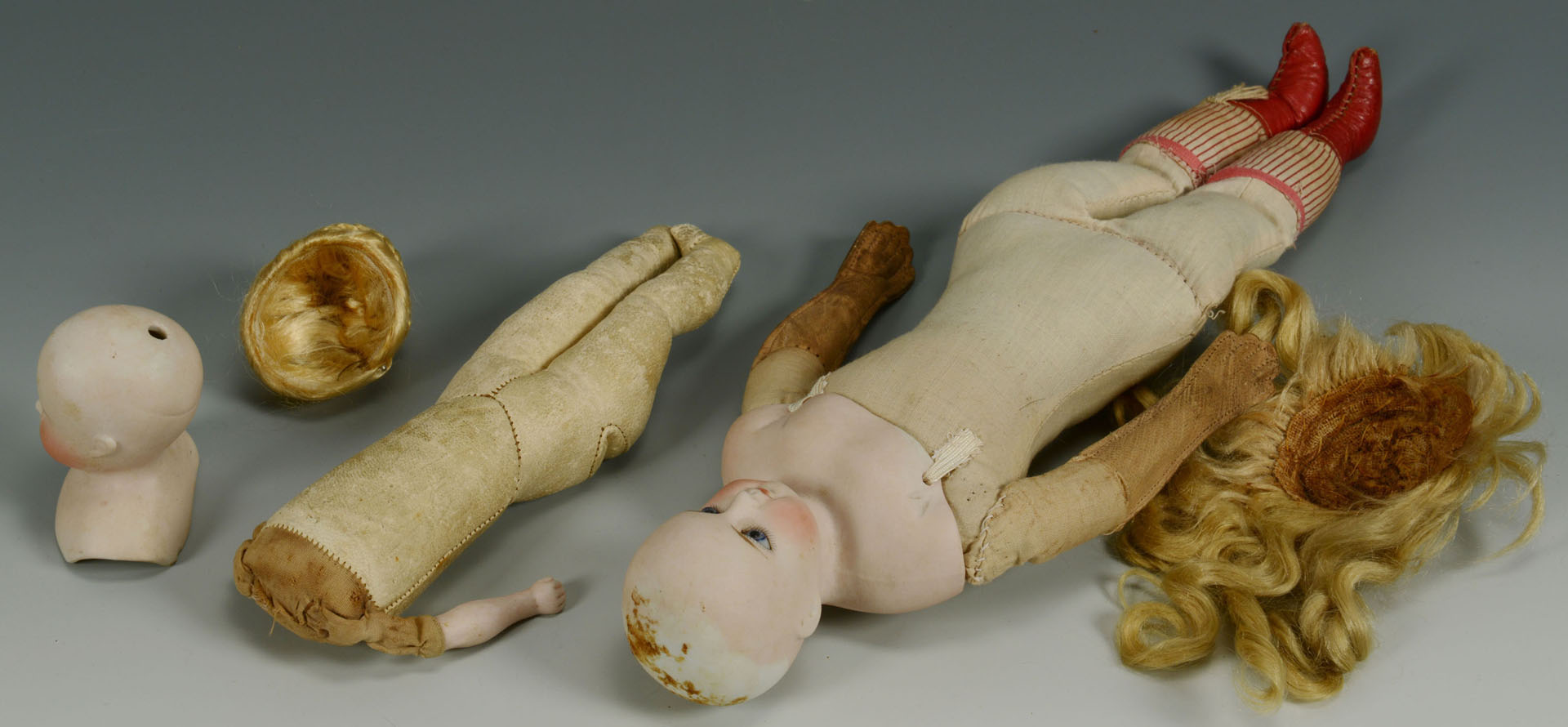 Lot 680: 2 Early Bisque Head Fashion dolls and extra clothe