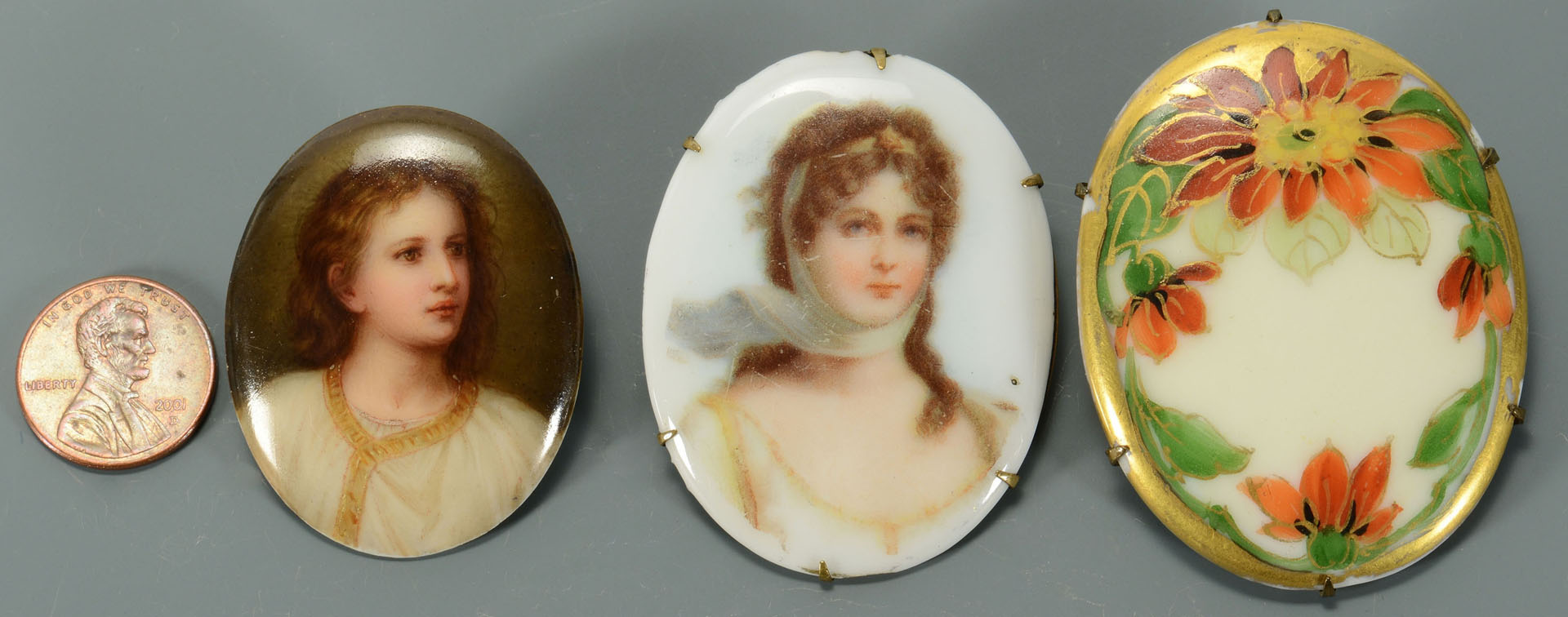 Lot 741: Three miniature paintings on porcelain inc. 2 pins