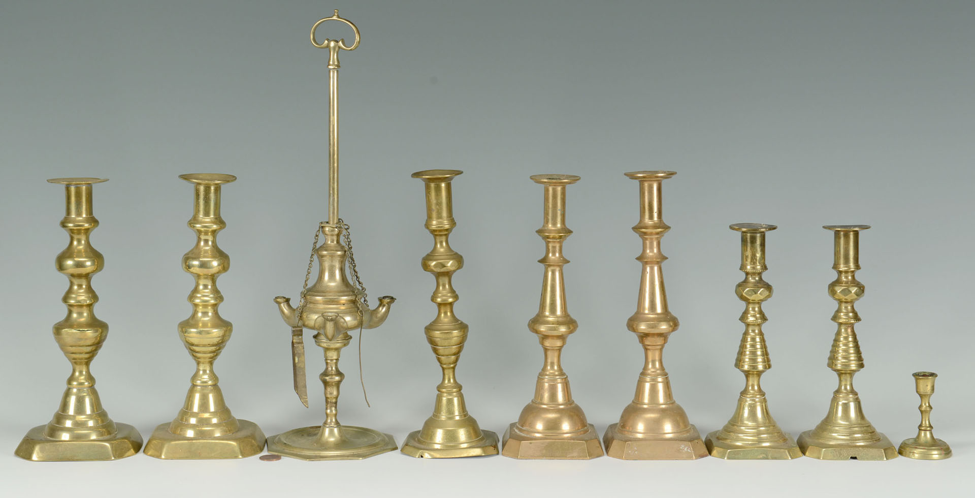 Lot 756: Grouping of Brass Candlesticks, 19th c.