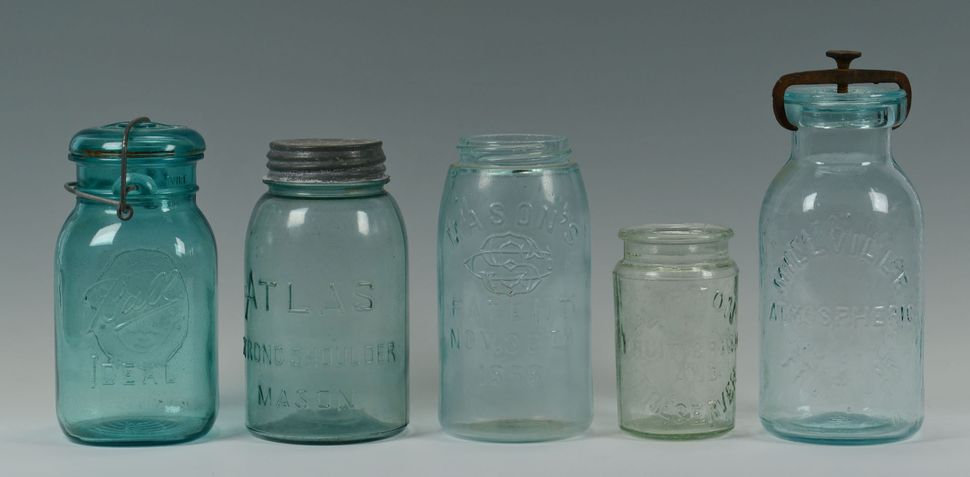 Lot 757: Grouping of 10 Early Canning Jars & water bottle