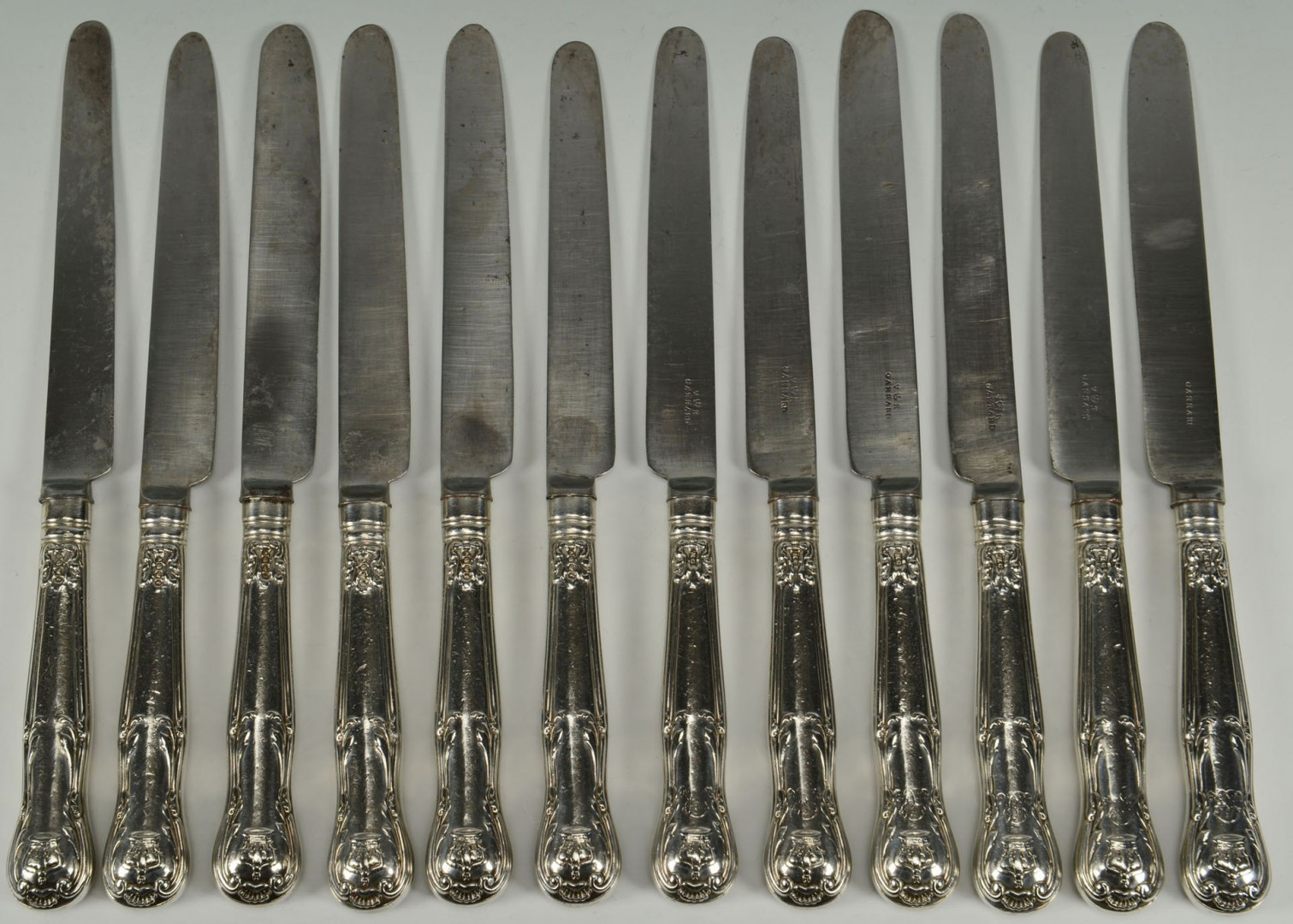 Lot 94: 12 sterling knives by Mary Chawner for Queen Adela