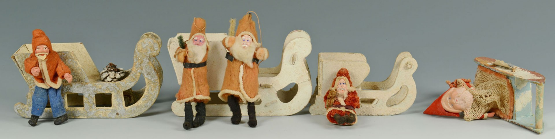 Lot 2872312: Grouping of early Santa Claus figures with sleighs