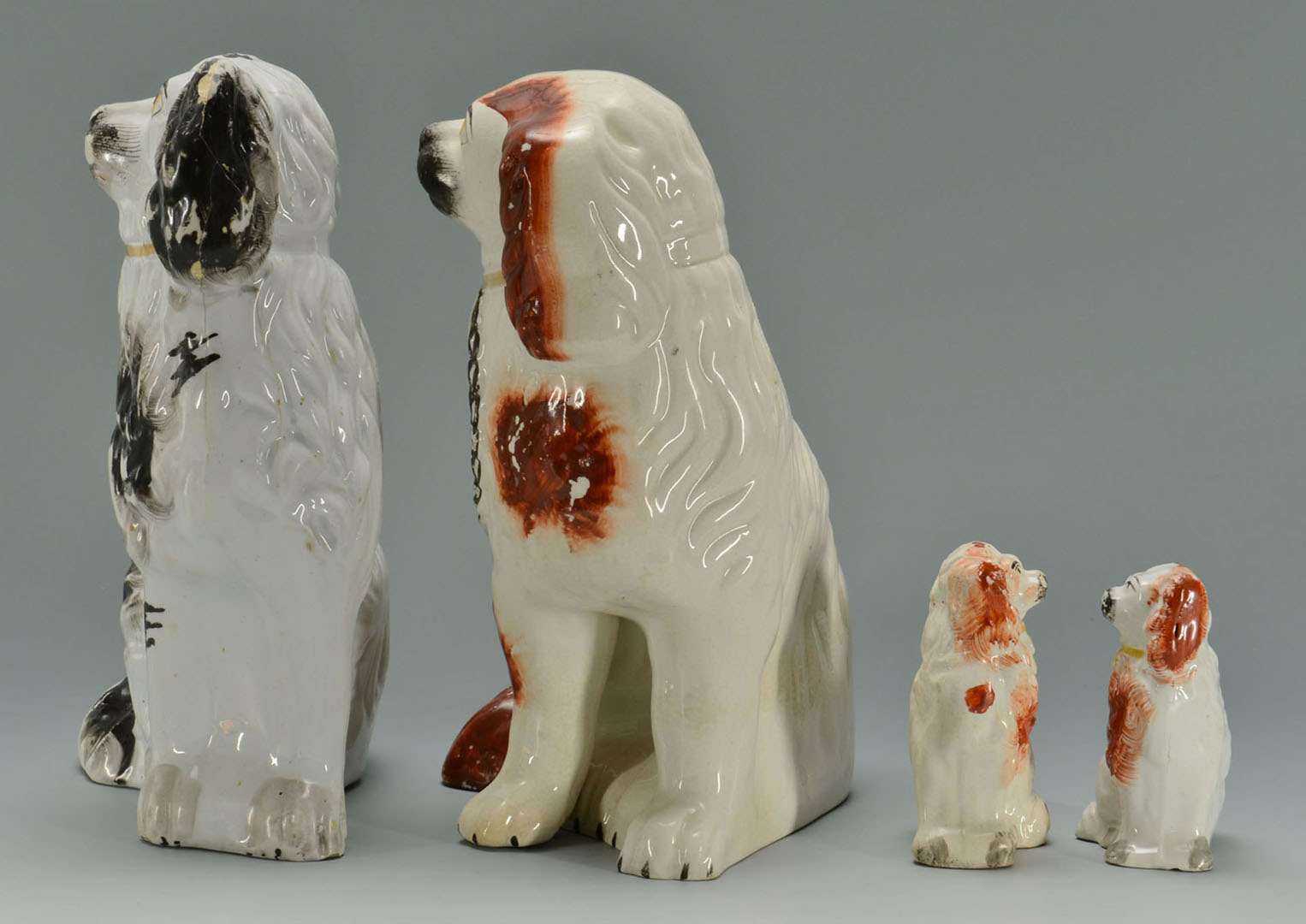 Lot 2872341: Grouping of 4 Staffordshire Spaniel dogs