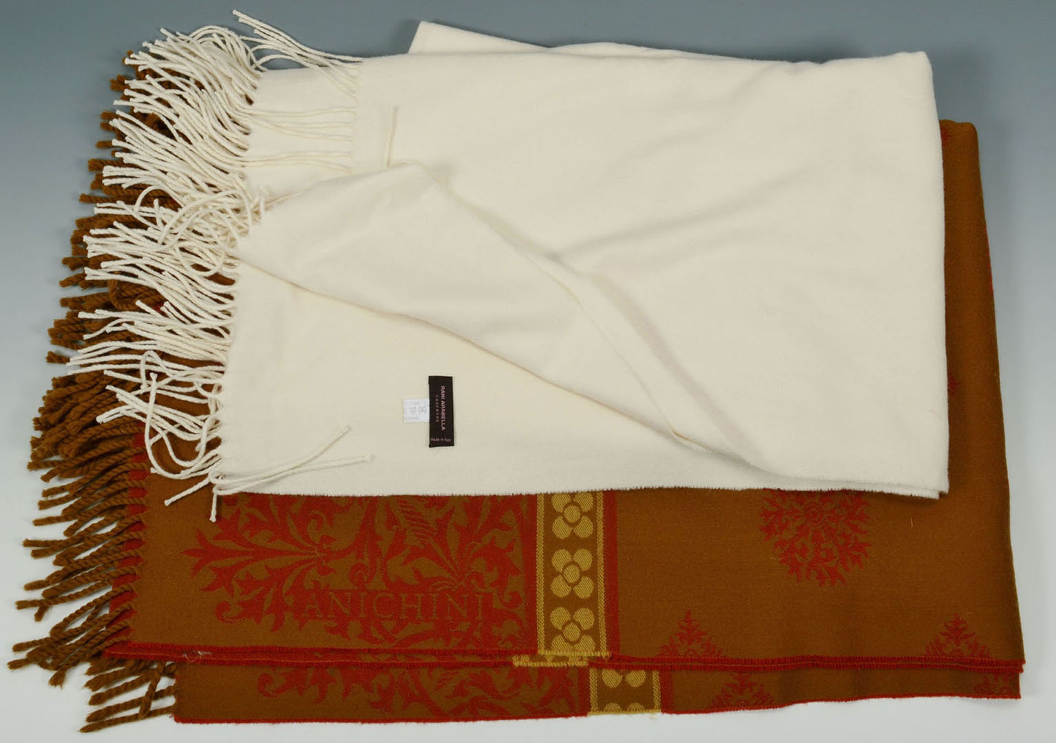 Lot 2872357: Group of designer blankets, pillows and napkins