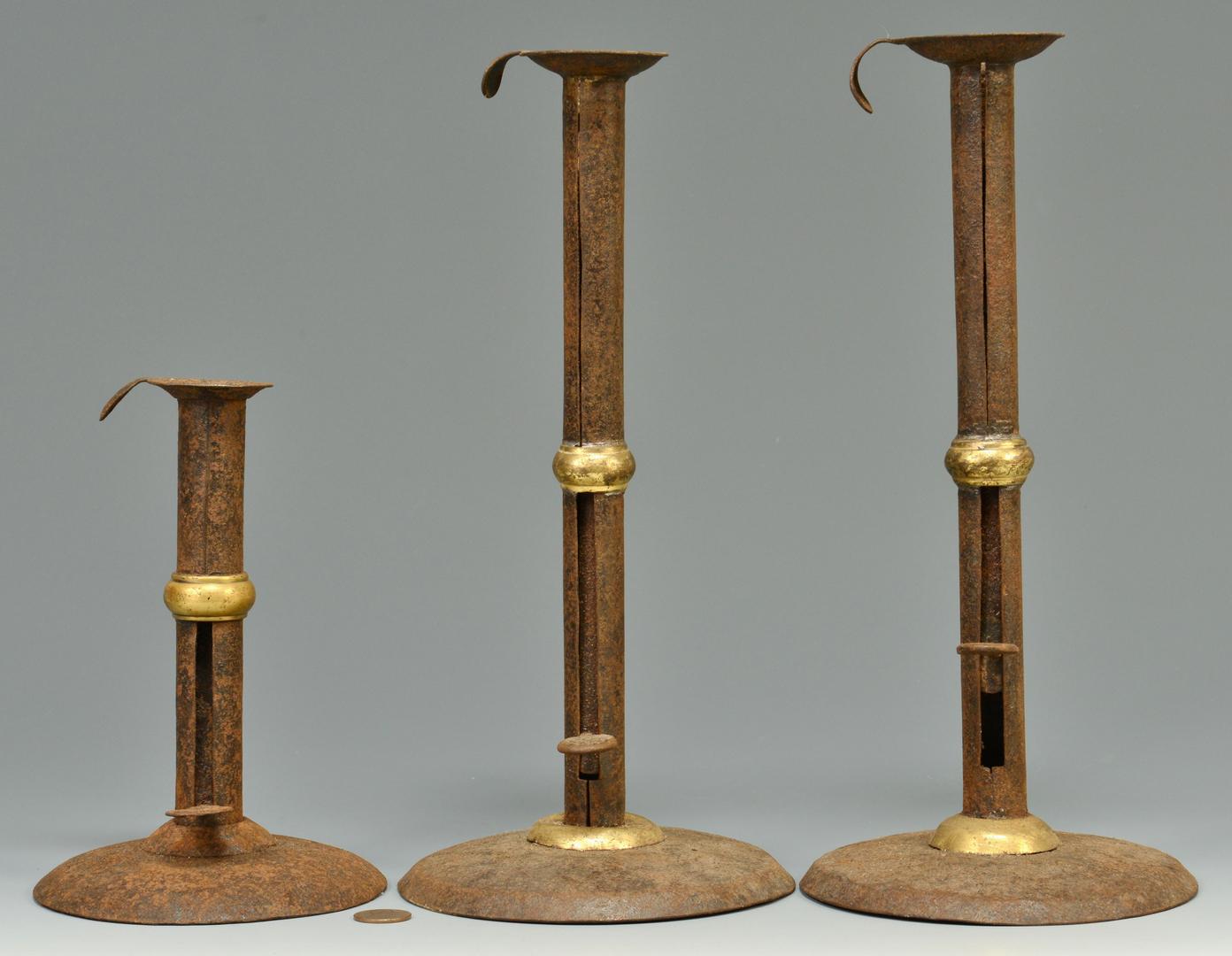 Lot 3088116: 3 Brass Wedding Band Hogscraper Candlesticks