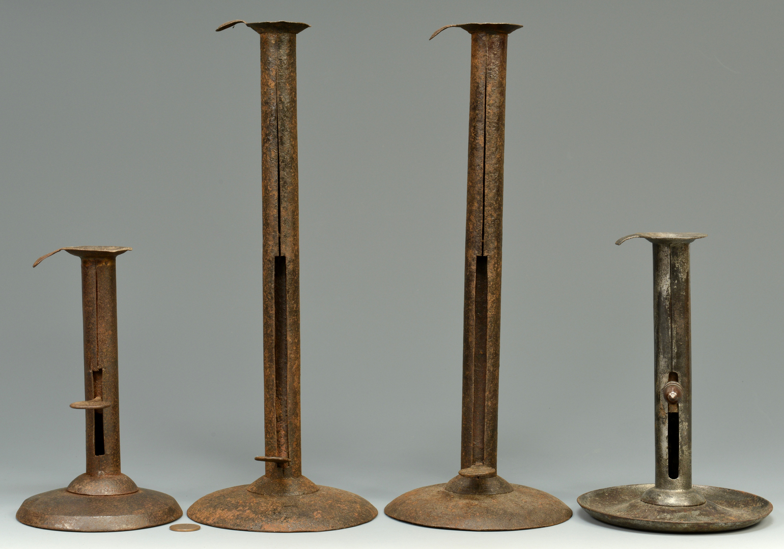 Lot 3088117: Group of 4 Metal Candlesticks