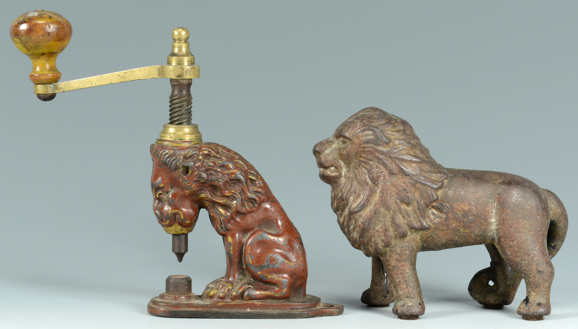 Lot 3088123: Cast Iron Lion Hole Punch and Bank