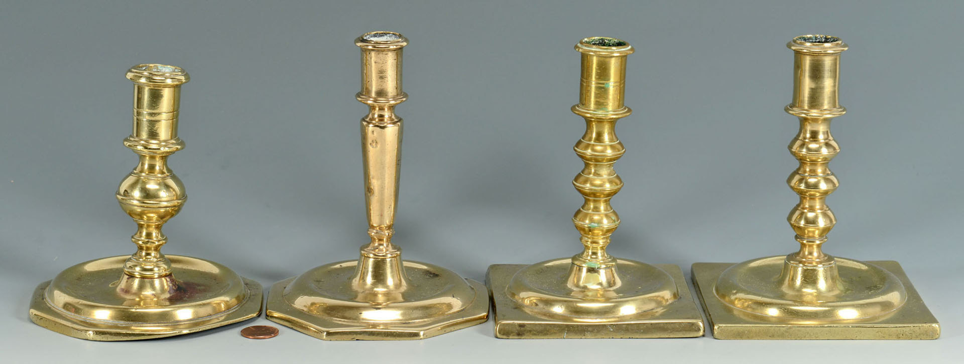 Lot 3088171: Four English Brass Candlesticks