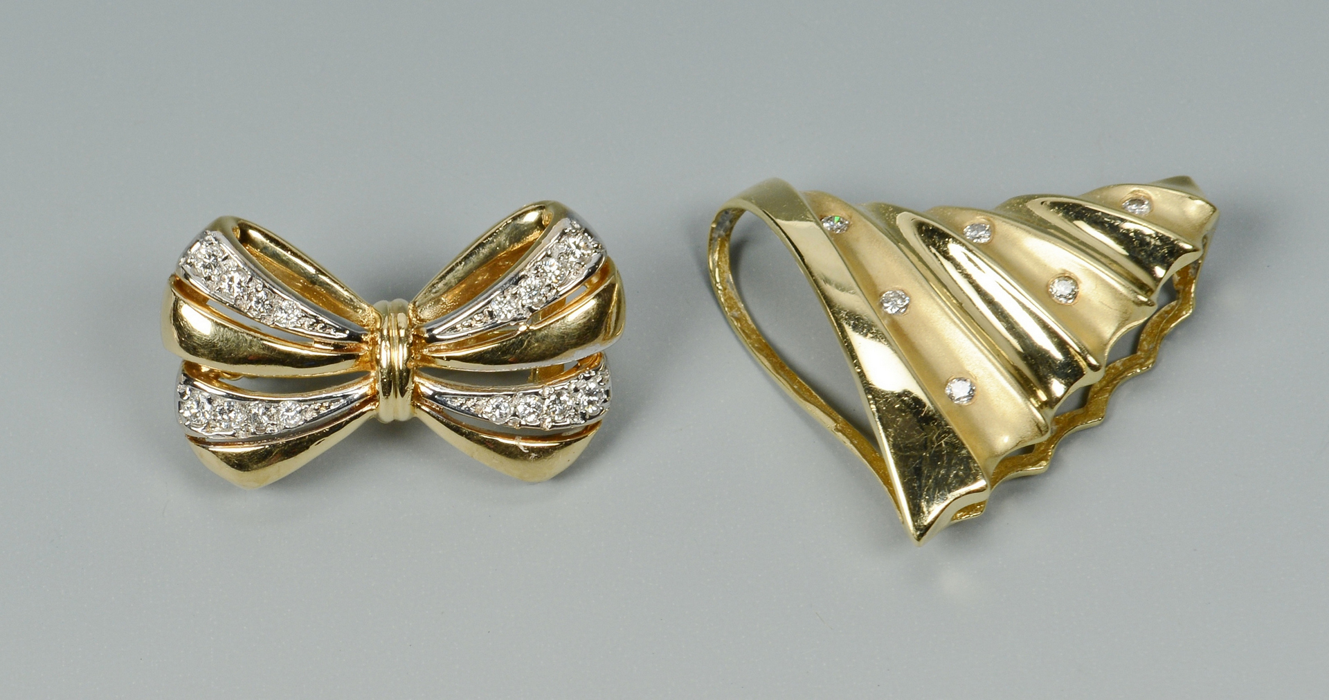 Lot 3088216: Two 14k and Diamond Necklace Enhancers