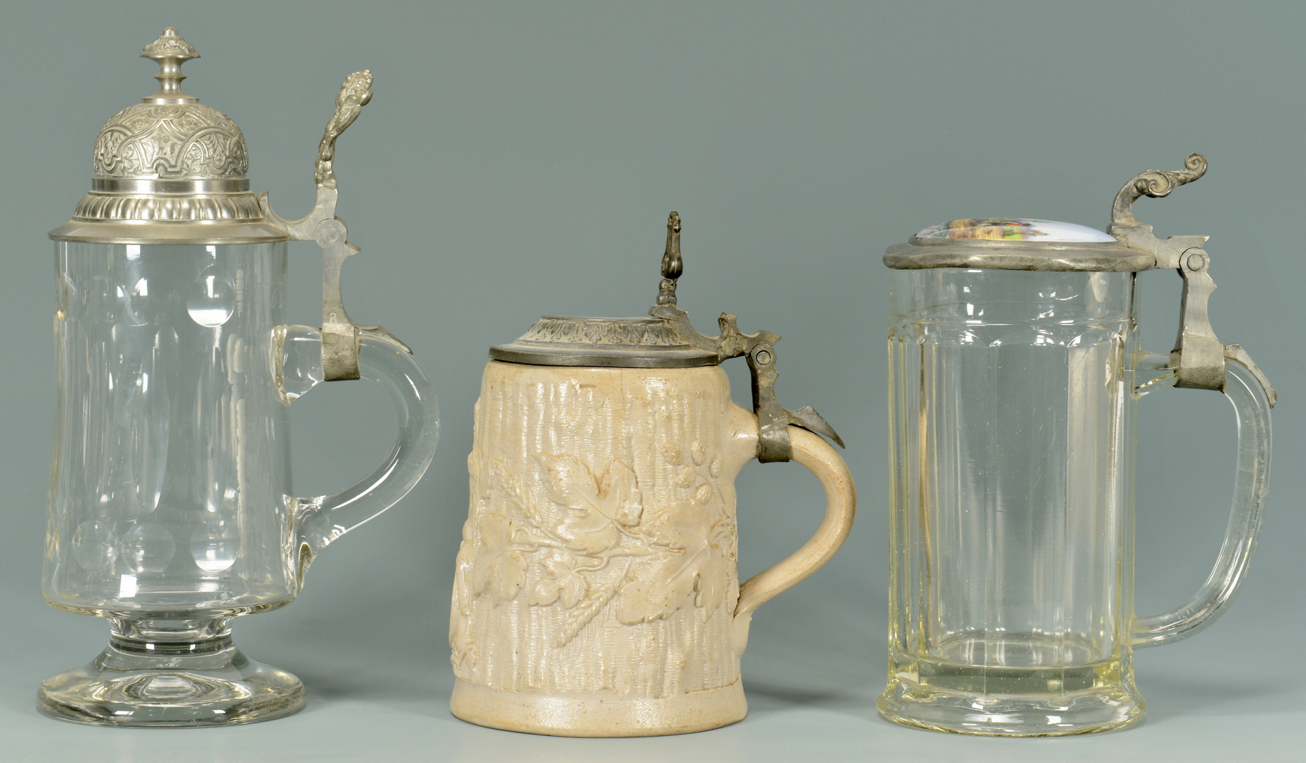 Lot 3088352: 7 German Steins – 4 Glass & 3 Earthenware