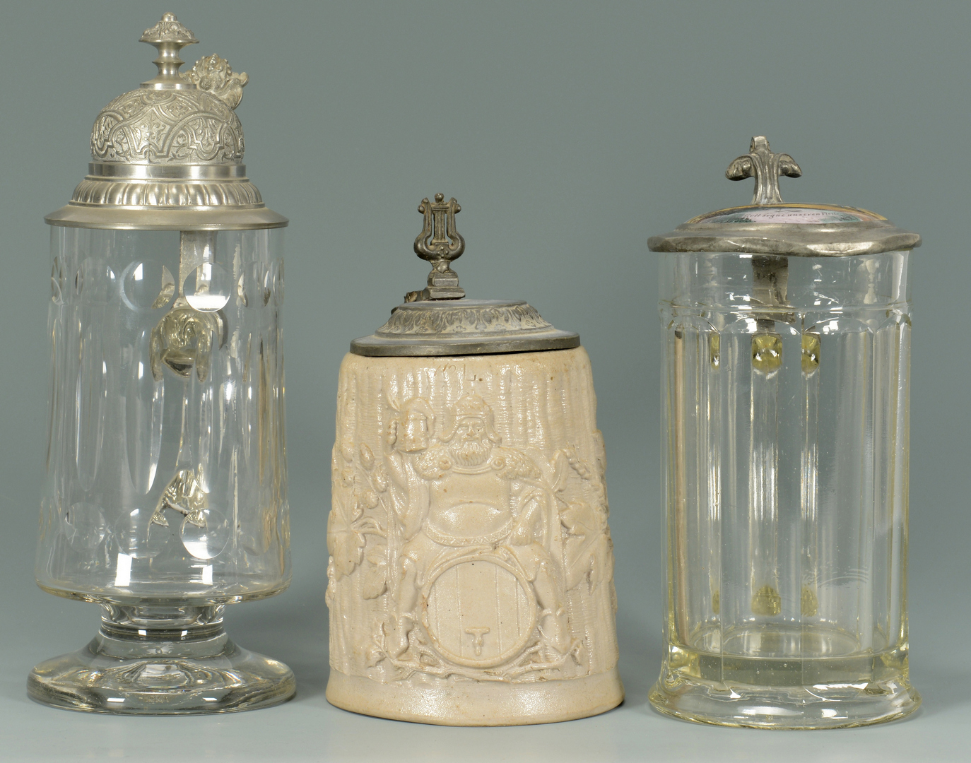 Lot 3088352: 7 German Steins – 4 Glass & 3 Earthenware