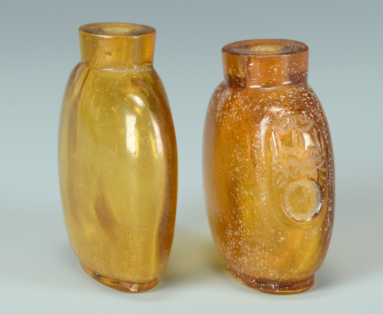 Lot 3383144: Two Amber Snuff Bottles