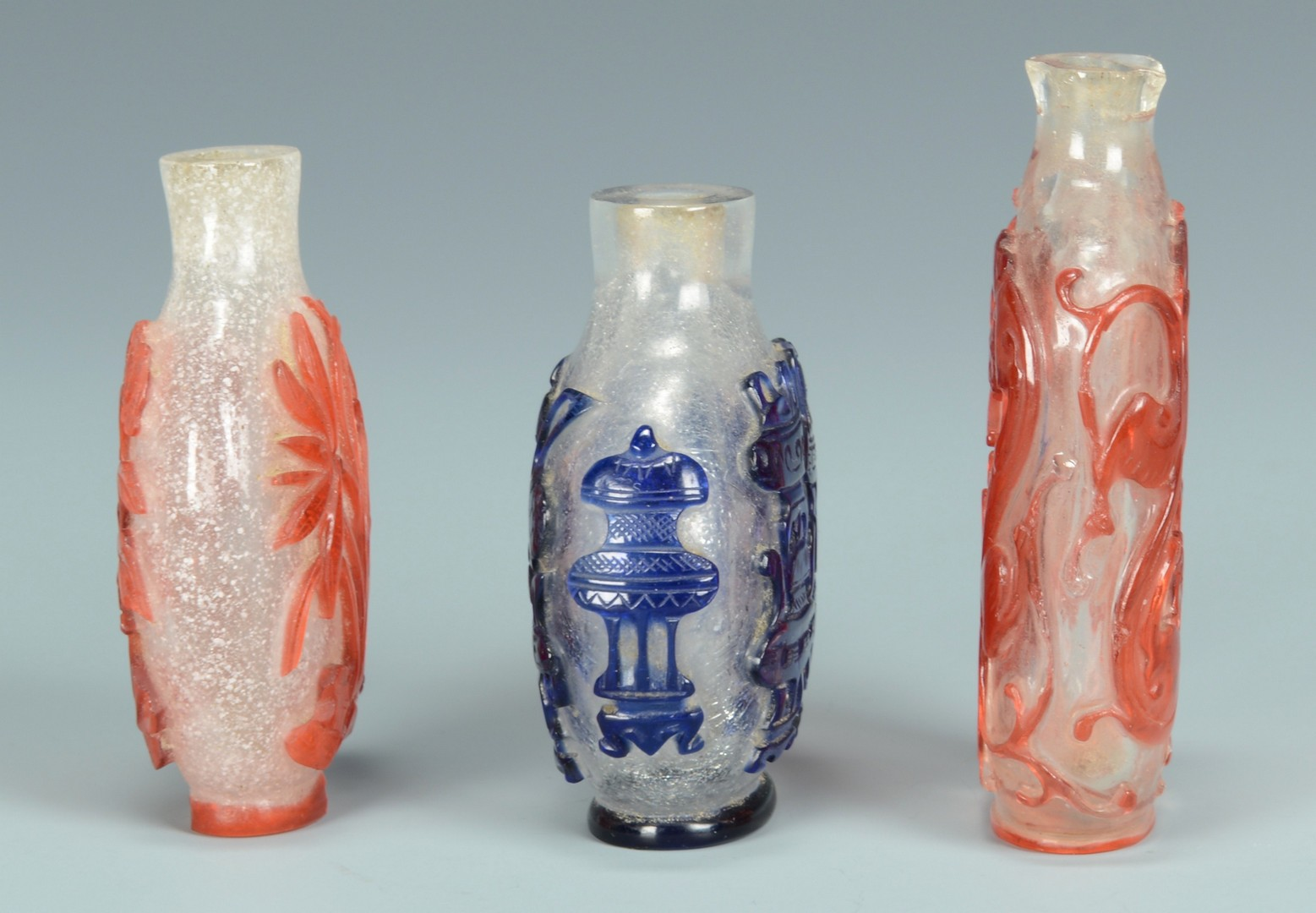 Lot 3383145: Three Chinese Overlay Carved Snuff Bottles