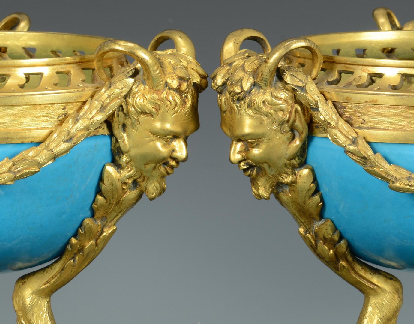 Lot 160: Pr Porcelain Orbs, satyr head masks
