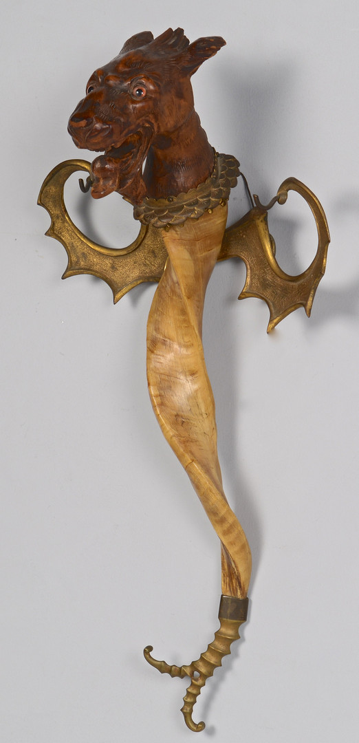 Lot 23: Carved Griffin & Decorative Brass