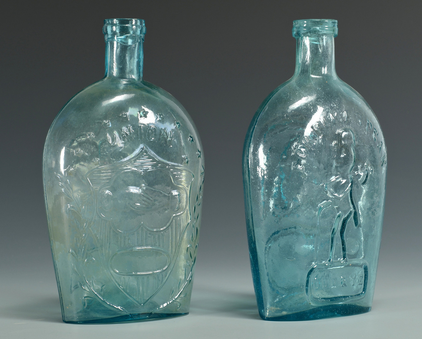 Lot 354: 19th C. Butter Molds and Flasks