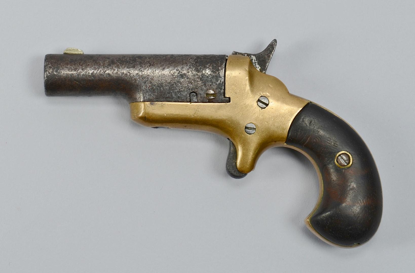 Lot 392: Colt Cloverleaf and 3rd Model Deringer, 2 items