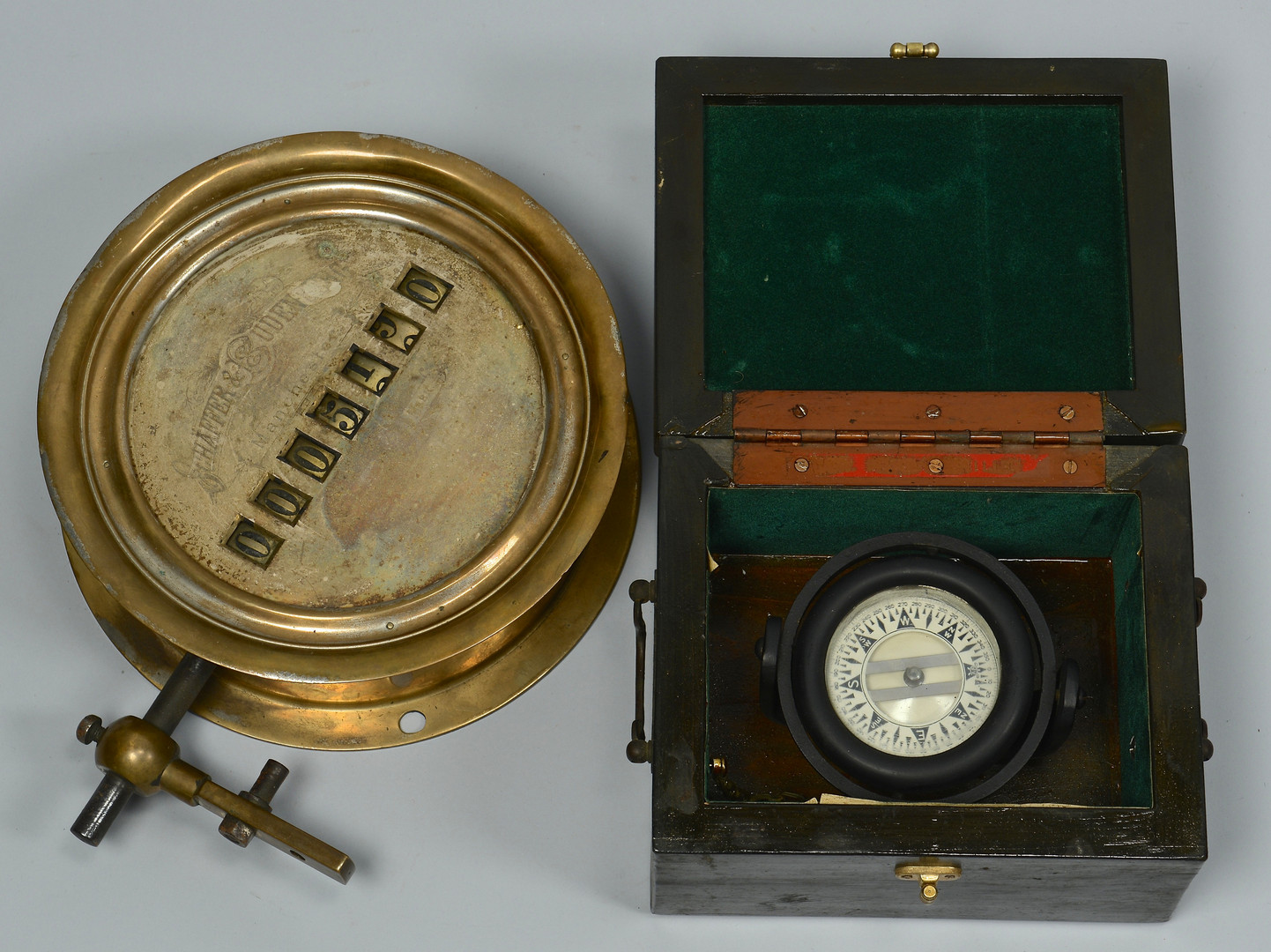 Lot 425: Grouping of Two Compasses and Counting Device