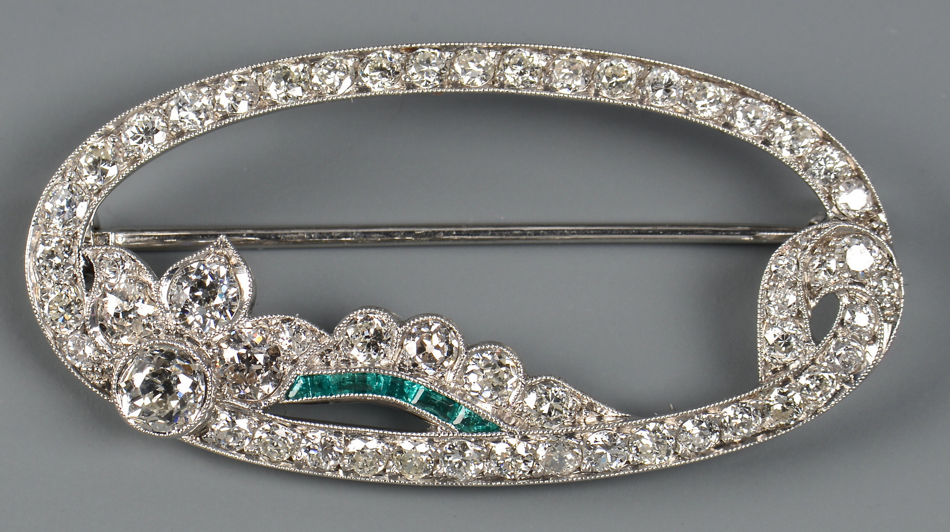 Lot 43: Platinum, Diamond Emerald Pin