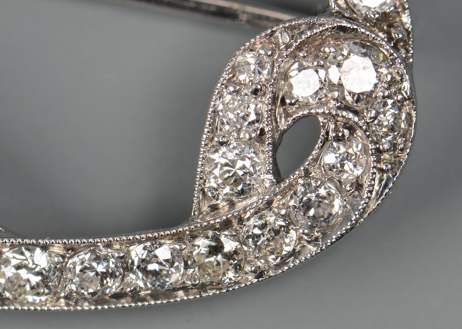 Lot 43: Platinum, Diamond Emerald Pin