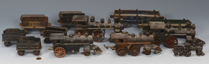 Lot 472: Group of 12 Cast Iron Trains, Cars