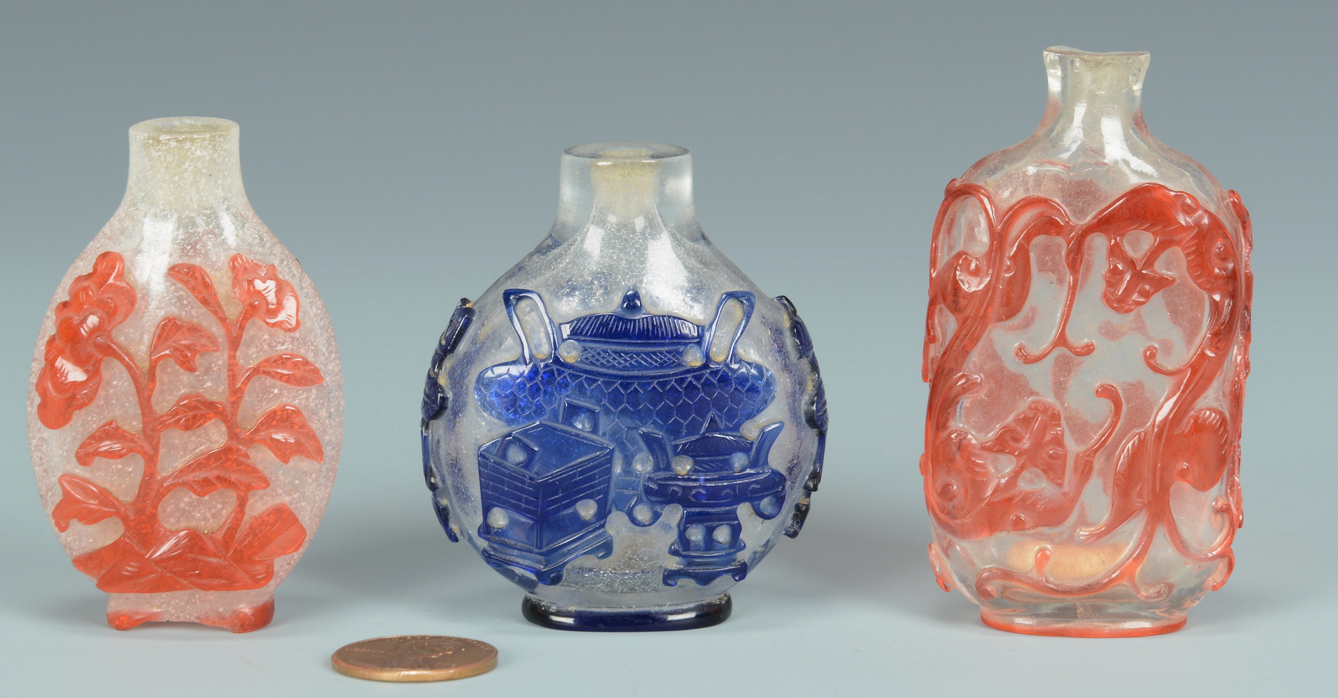 Lot 573: 3 Chinese Overlay Carved Snuff Bottles