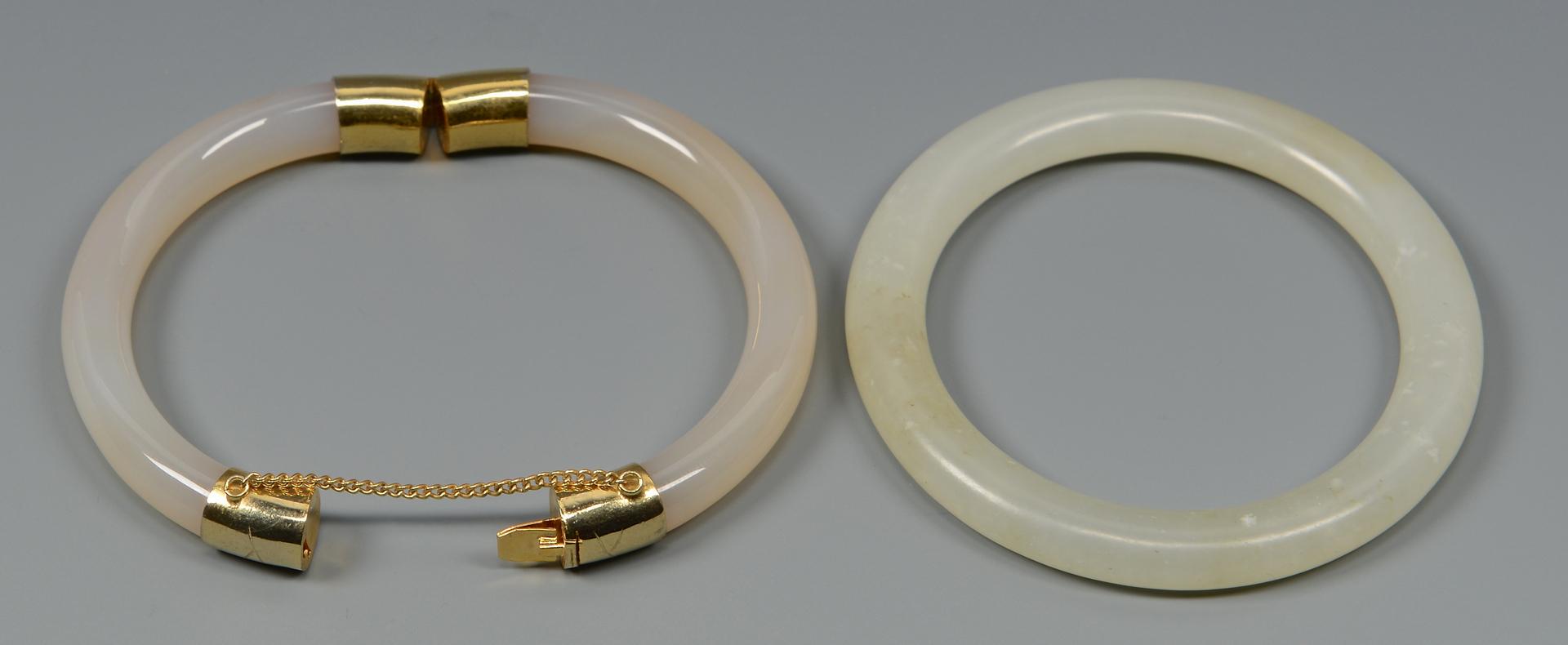Lot 575: Pair White Jade Bangle Bracelets