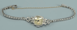 Lot 585: Bulova Diamond/Platinum Watch