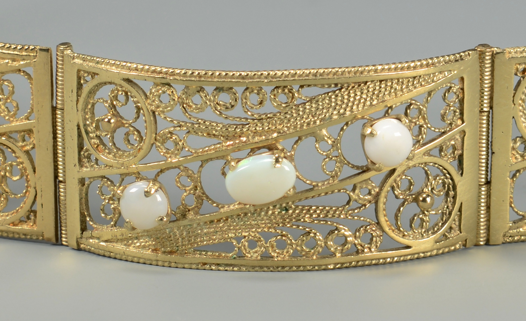 Lot 590: 14K Yellow Gold and Opal Bracelet