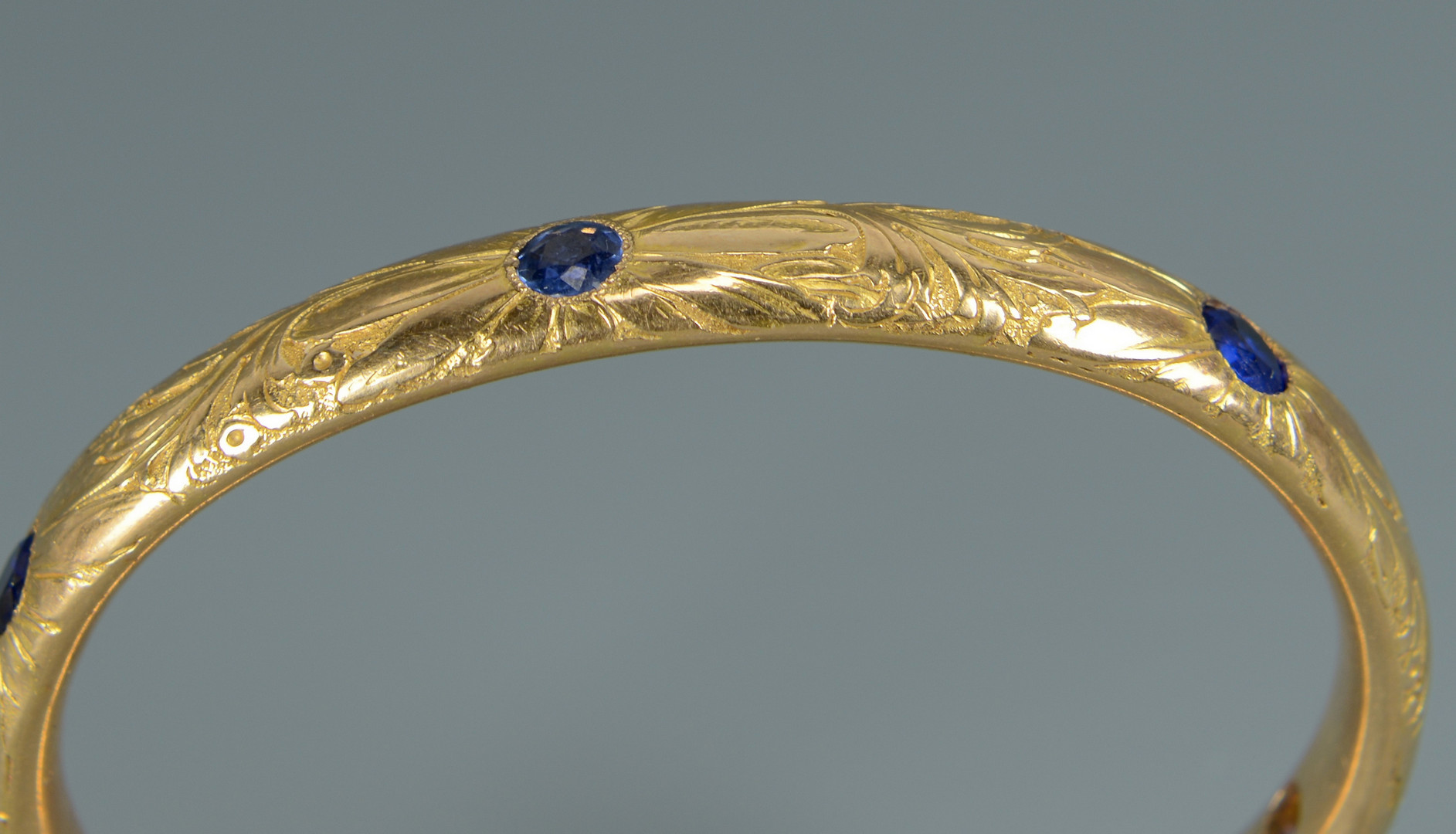 Lot 591: 14K Bangle Bracelet w/ Stones