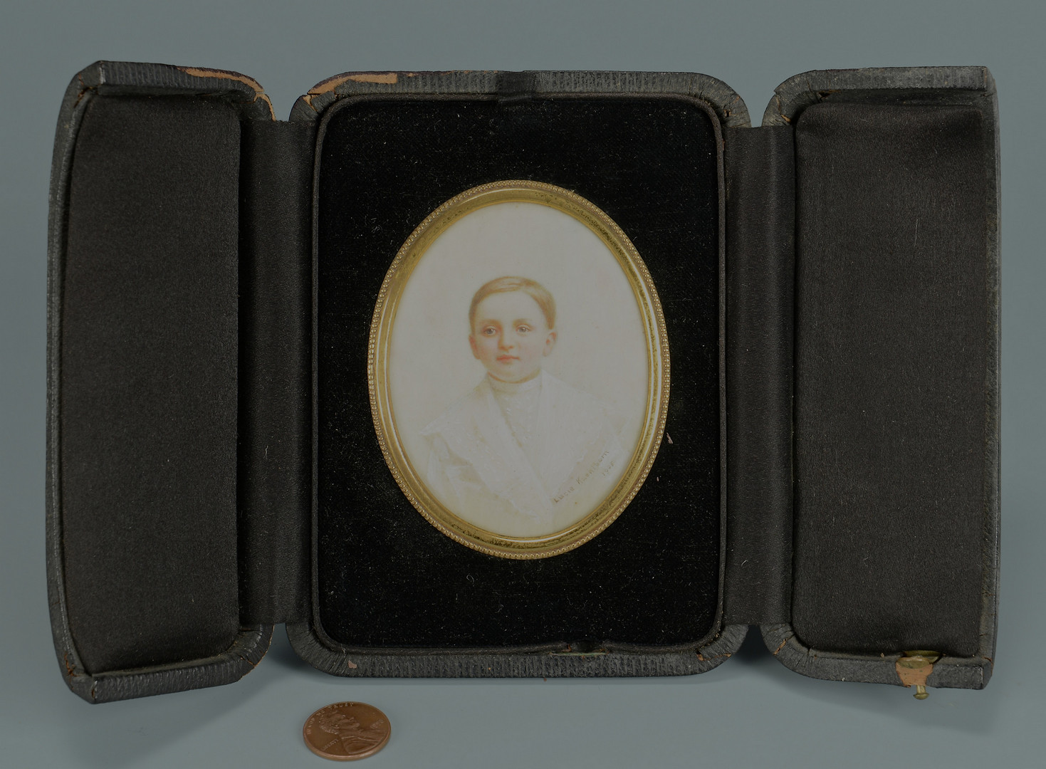 Lot 677: American Miniature, signed