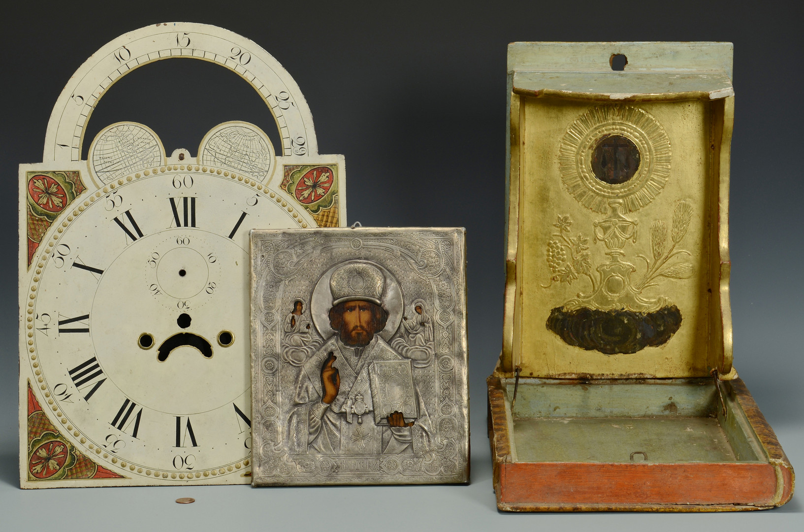 Lot 702: Religious Objects and Clock Face