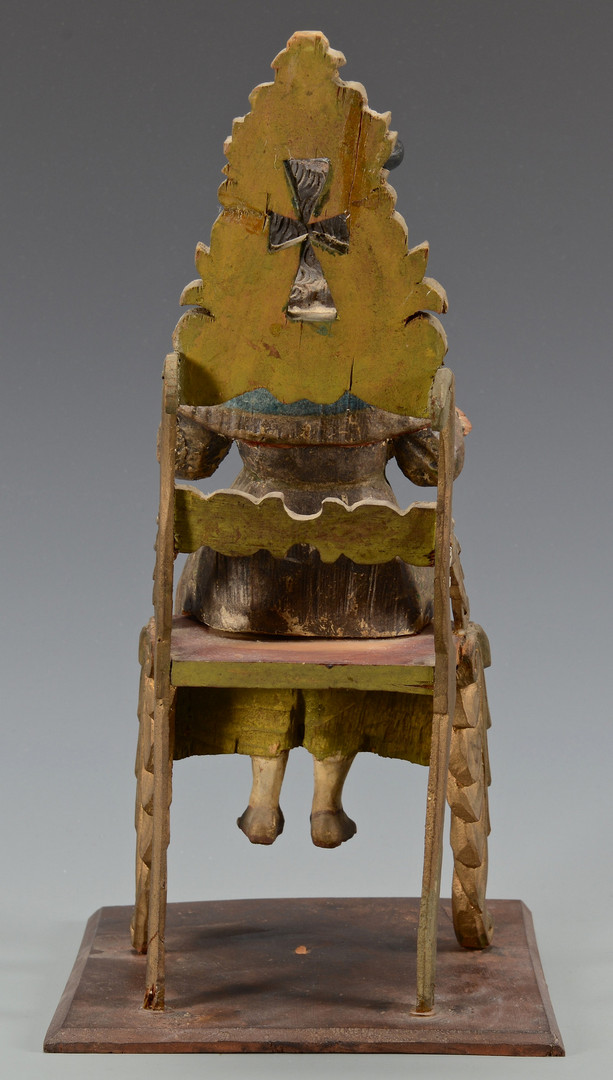 Lot 703: Carved Polychrome Santos on Chair
