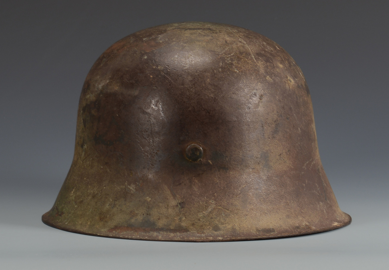 Lot 729: German M42 Helmet w/ Camouflage
