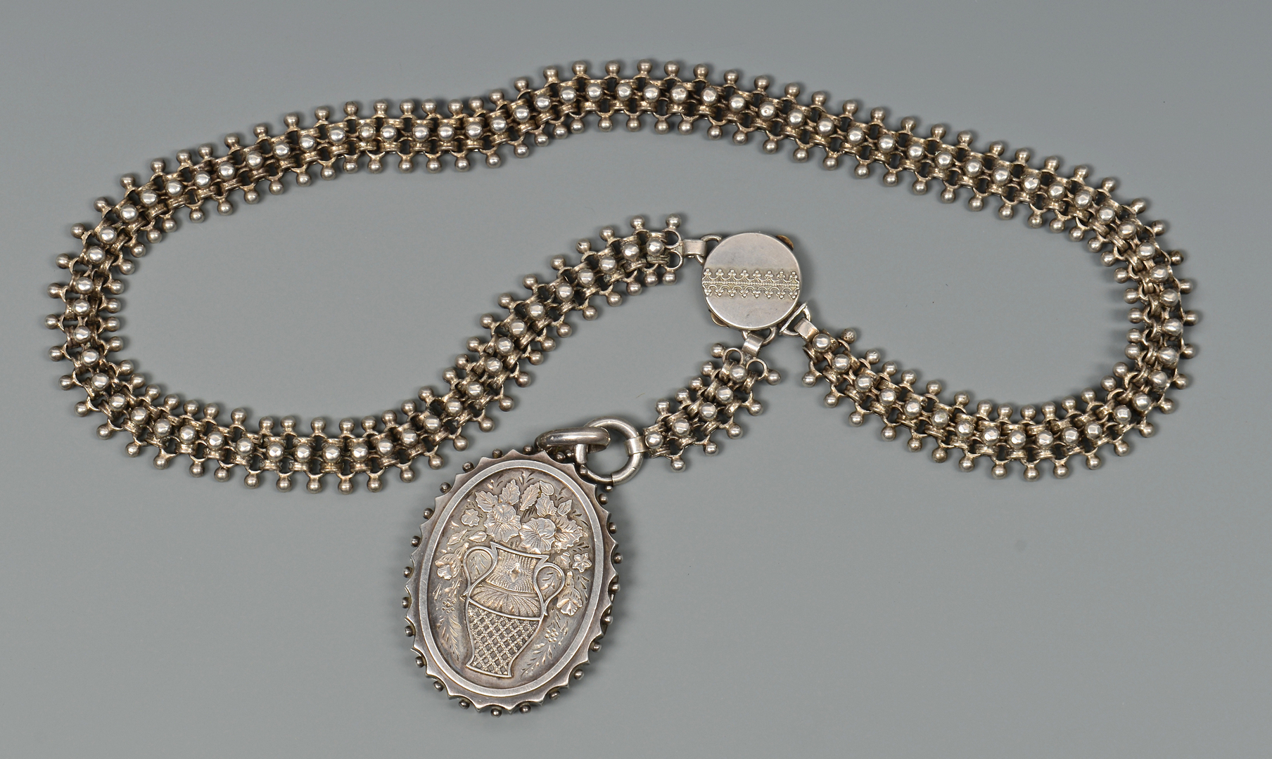Lot 803: Victorian Silver Locket and Chain