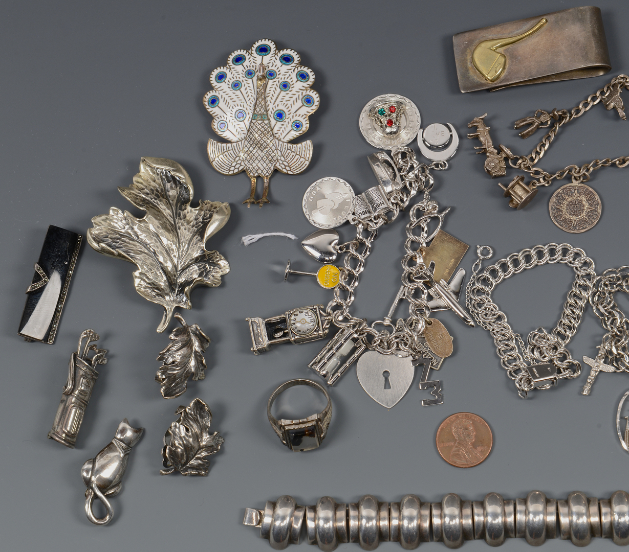 Lot 817: Sterling Charm Bracelets & Novelty Pins