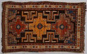 Lot 830: Kazak Rug w/Star Border and Orange Center