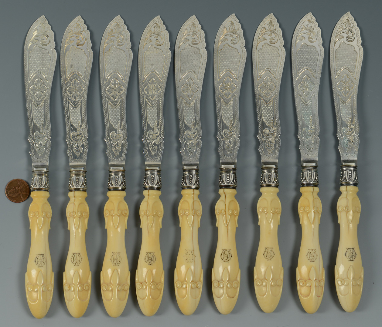Lot 843: 9 English fish knives