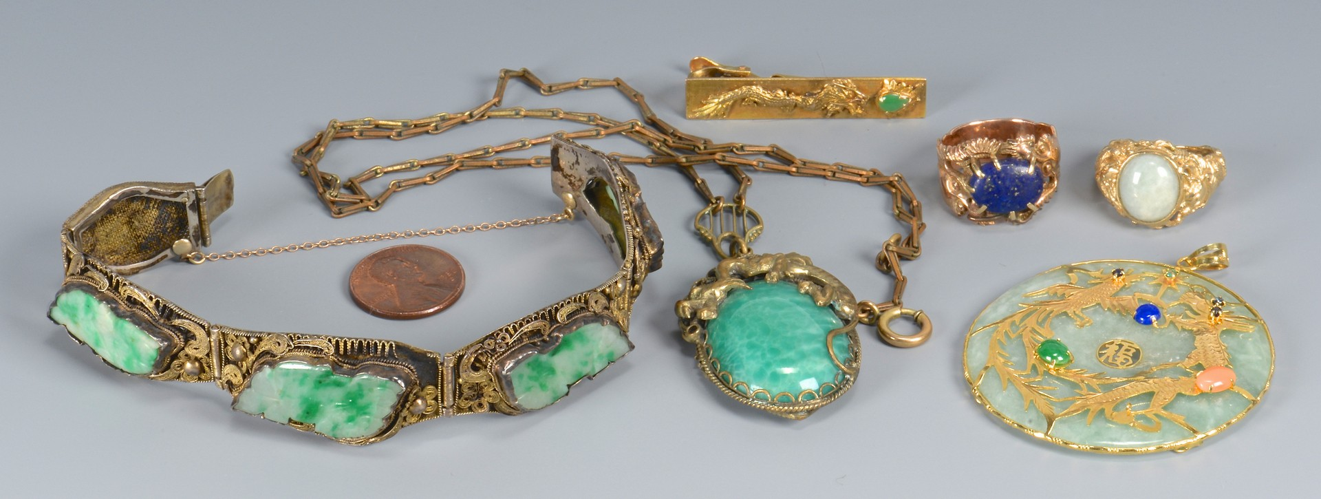 Lot 3594153: Gold and Jade Jewelry with dragon design