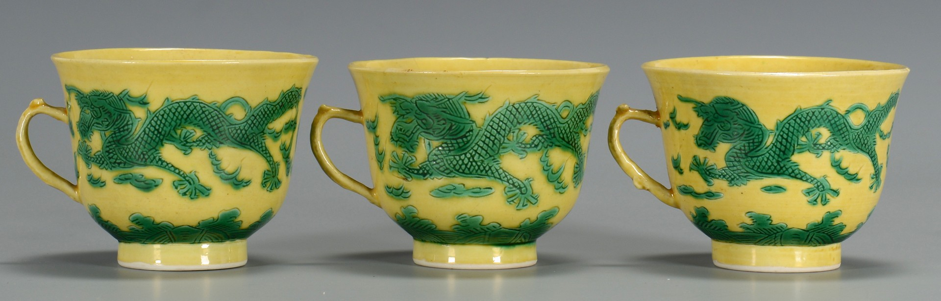 Lot 3594163: Set Qing yellow cups/saucers