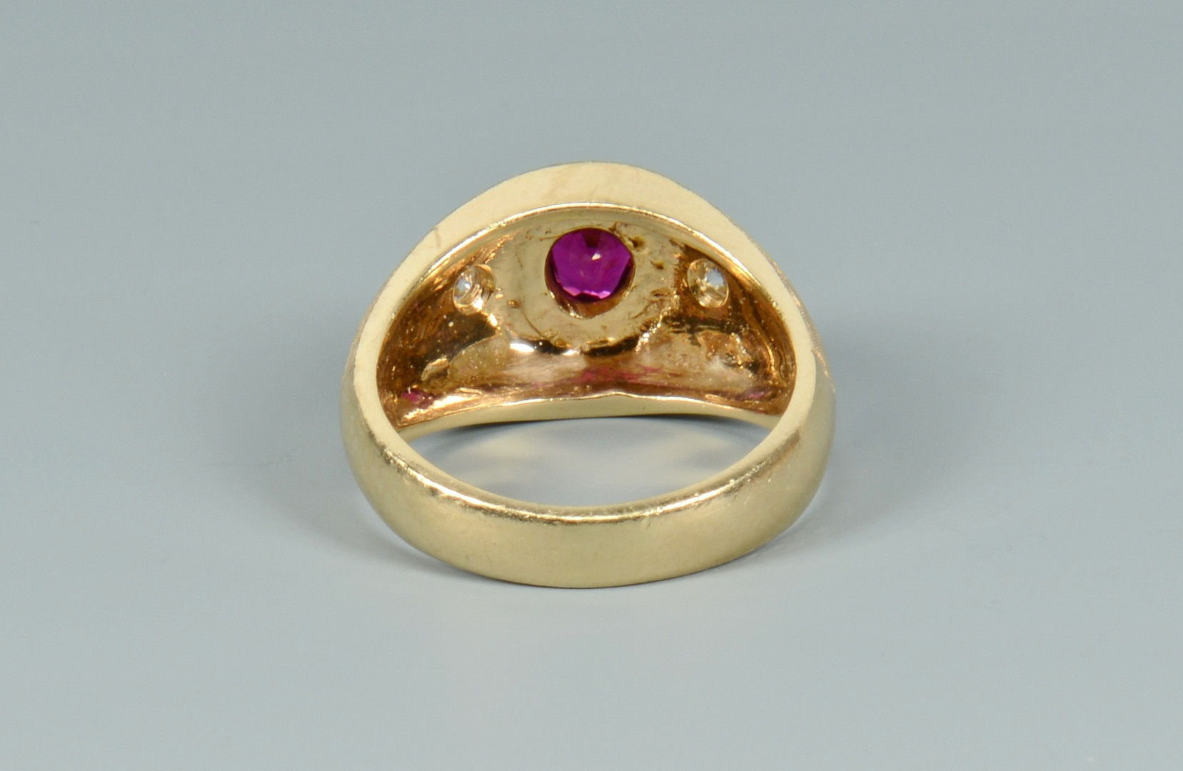 Lot 104: 14k ruby and diamond ring