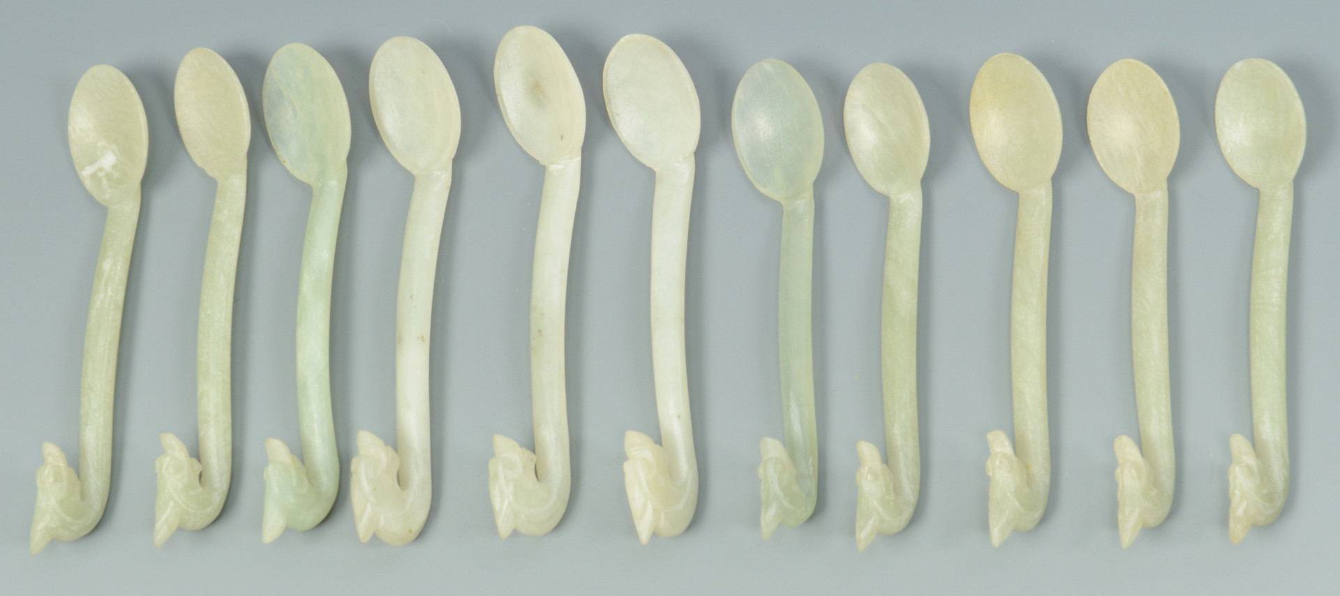 Lot 16: 12 Dragon Carved Hardstone Spoons, Cups and Saucer