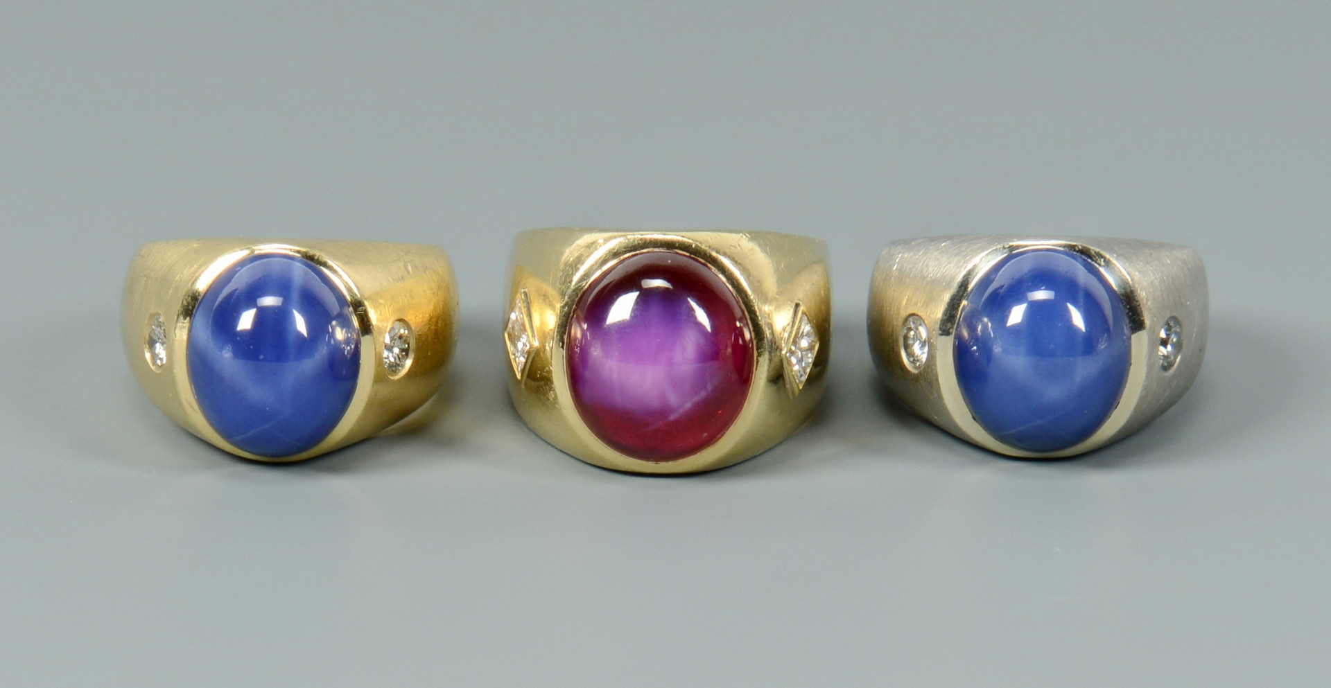 Lot 253: Three 14k rings with diamonds plus