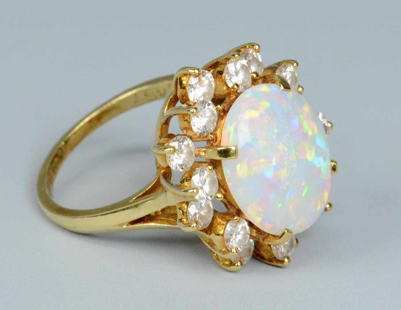 Lot 258: 18k Opal and Diamond Ring